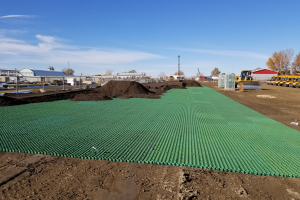 CORE Grass driveway and parking pads being installed at a Bus Facility