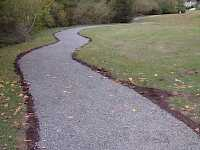 The finished pathway blends in naturally with the park, being contained the aggregate is held within the path.