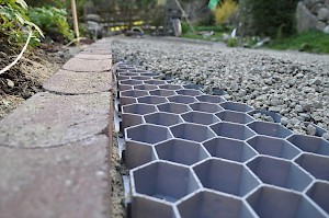 Permeable gravel driveways keep the rainwater in the soil, not sewers