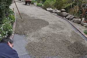 With the CORE Gravel grid foundation in place gravel is spread over the hexagonal shaped cells.