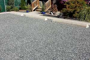 Visitor parking stalls at Habitat for Humanity installation using CORE gravel 60-40 grids