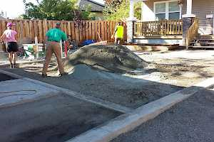 Volunteers prepare the parking stalls for a CORE Gravel installation.