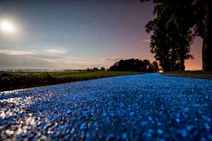 Blue glow chips embedded in a gravel surface - held together