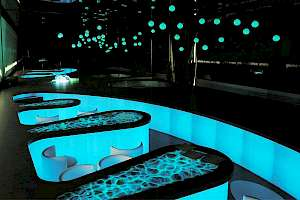 Glow pigments lining otherworldy lounge seating.