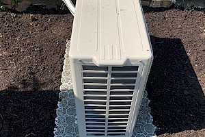 Top dress the area surrounding the heat pump for an attractive finish.