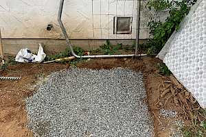 Fill the area with gravel to serve as a foundation for the foundation panel.