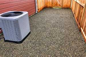 Heat pump installation using a CORE Landscape Heat Pump Foundation Kit.